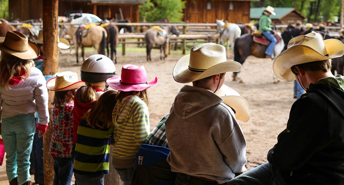 Kristin-Foster,-kids-at-horse-corral,-dude-ranch_web