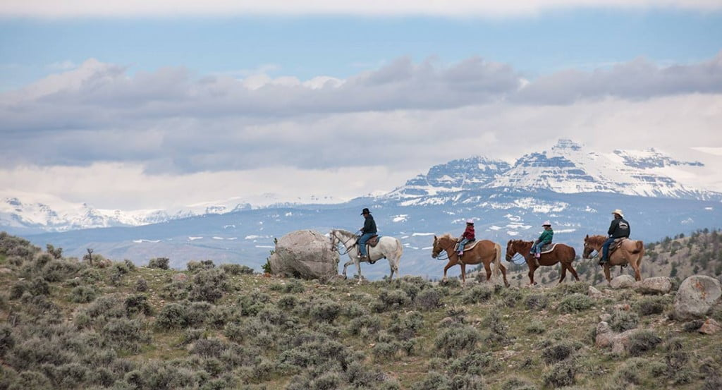 Horseback riders with the Absaroka Mountains in the background