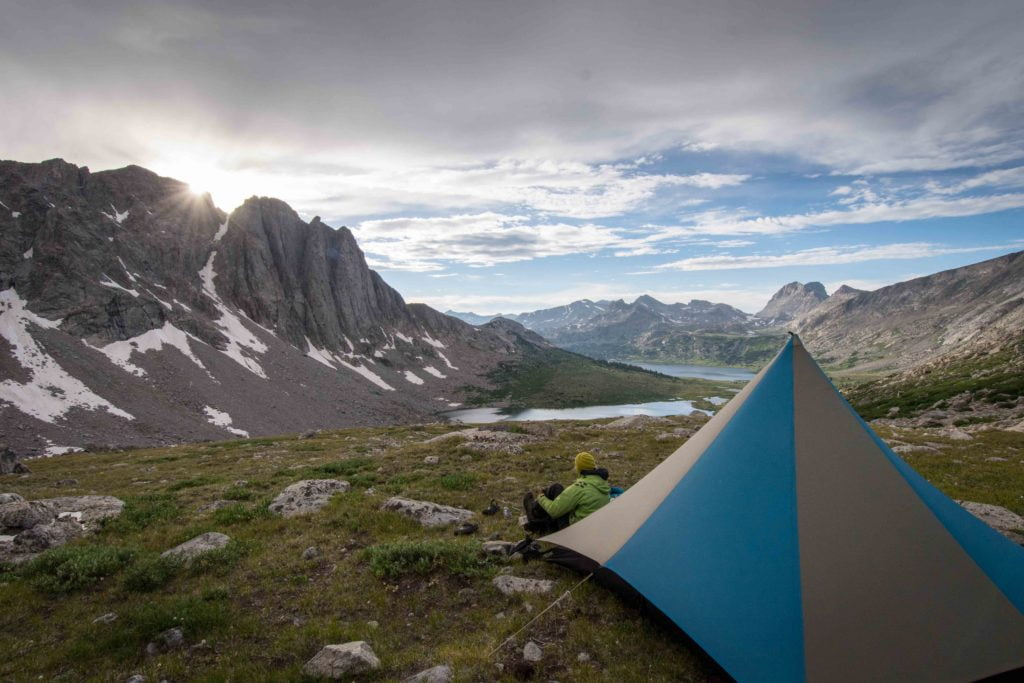 Tent in the backcountry with epic mountain views