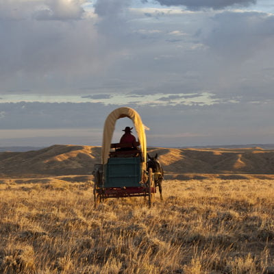 a covered wagon makes its way over prospect ridge