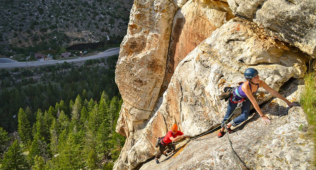 Two climbers on a wall in Sinks Canyon