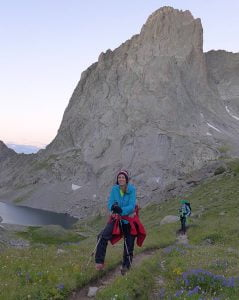 Tina, from North Carolina, hikes above Arrowhead Lake, in the Wind Rivers.