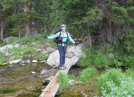 Meredith, from Arkansas, crosses a river in Wind River Country