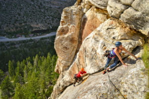 Two climbers make their way up a route in Sinks Canyon