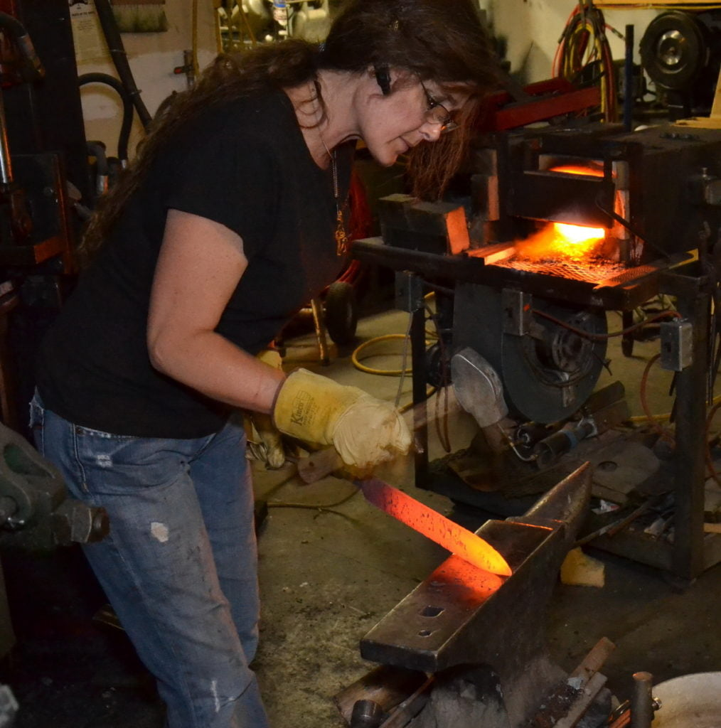 Audra Draper working in her shop