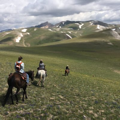 Women on horseback ride into a mountain adventure in Wyoming's Wind River Country